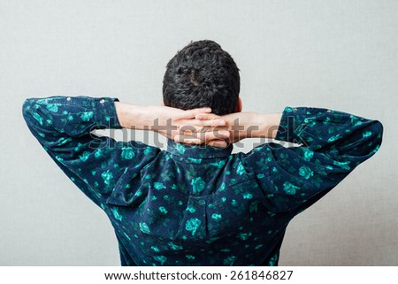 thoughtful young man. Rear view.  - stock photo