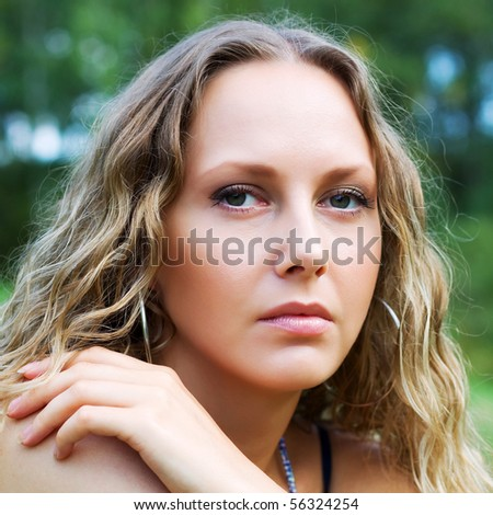 Thoughtful young woman. - stock photo