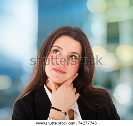 Thoughtful young woman portrait - stock photo