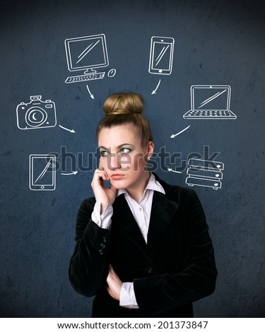Thoughtful young woman with multimedia icons around her head - stock photo