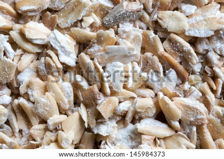 Thousands of oats flakes as a background - stock photo