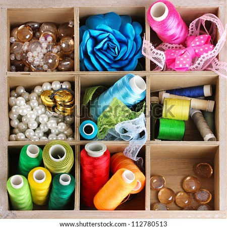 Thread and material for handicrafts in box isolated on for Waste material handicraft