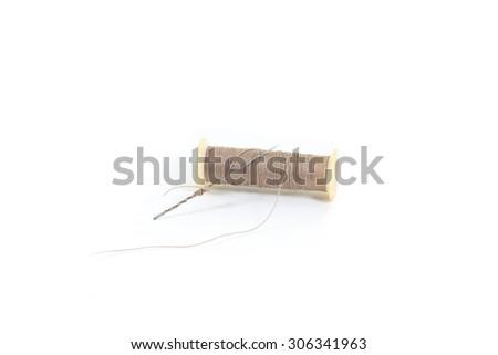 Thread and needle isolated on white background - stock photo