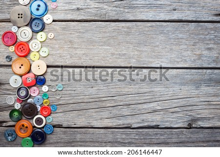 thread and sewing on wooden boards  - stock photo