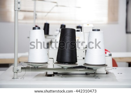 Thread Spools On Workbench At Factory - stock photo