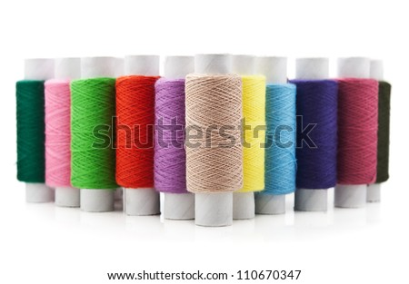 threads multicolored isolated on white background - stock photo