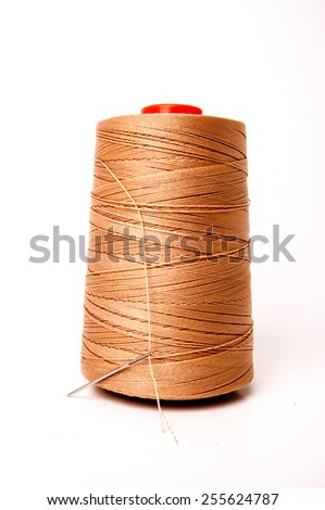 Threads Reel Nylon (Orange,Brown) with Needle for Embroidery isolated on white background / Concept and Idea of Textile Factory, Fashion Industry and Denim made. - stock photo