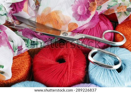 Threads, scissors and flower fabric - stock photo
