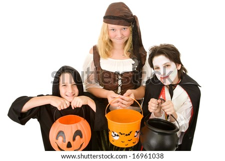 Three adorable trick or treaters begging for Halloween candy.  Isolated on white background. - stock photo