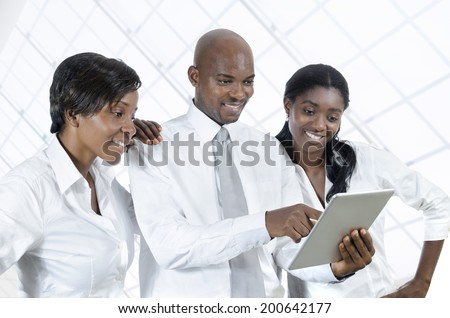 Three african business people with tablet PC, Studio Shot - stock photo