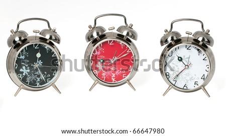 three alarm clocks - stock photo