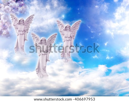 three angels over mystical cloudy sky - stock photo
