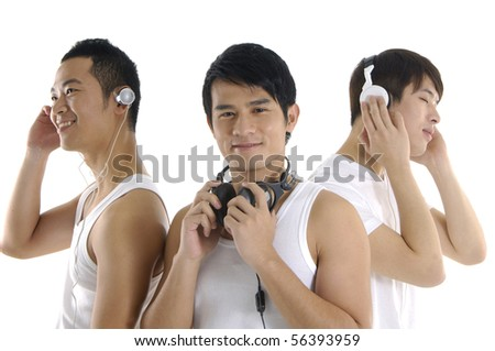 Three asian young male listening music in headphones - stock photo