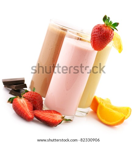 Three assorted protein cocktails with fruits isolated on white background. - stock photo