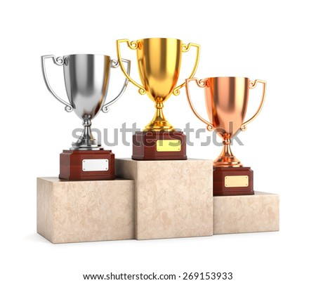Three award goblet trophies: gold, silver and bronze trophy cups on marble pedestal isolated on white background. - stock photo