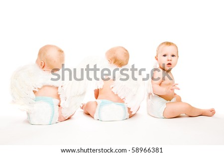 Three baby angels with the white wings - stock photo