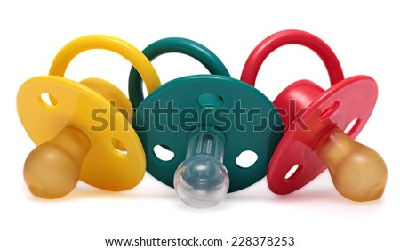 Three baby's dummy red, yellow and green isolated on white background.  - stock photo