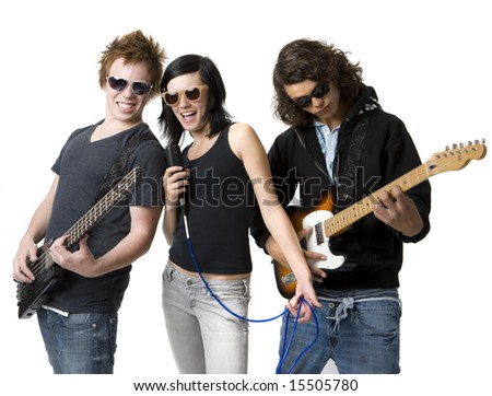 Three bandmates sing and play guitar - stock photo