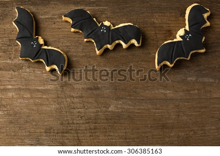 Three bat flying on wood background halloween - stock photo