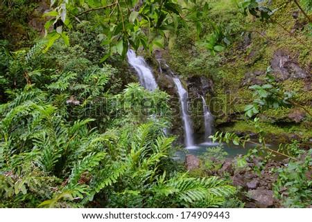 Three Bear Falls or Upper Waikani Falls on the Road to Hana, Maui, Hawaii - stock photo