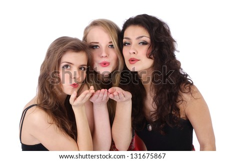 Three beautiful caucasian woman's send a kiss isolated over white background - stock photo