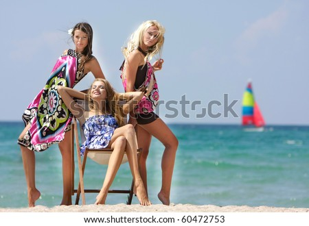 three beautiful girls on beach - stock photo