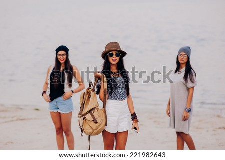 three beautiful girls on the beach - stock photo