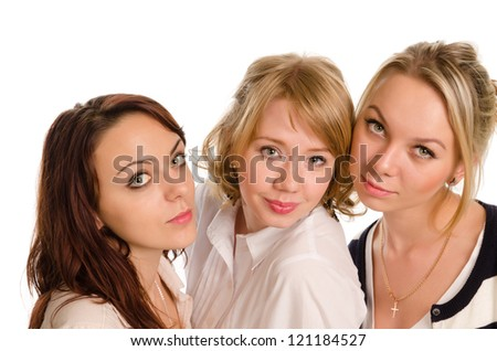 Three beautiful stylish young college students posing close together looking up at the camera with a smile isolated on white - stock photo