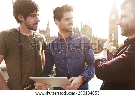 Three best friends touring the London - stock photo