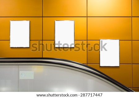 Three big vertical / portrait orientation blank billboard with escalator background - stock photo