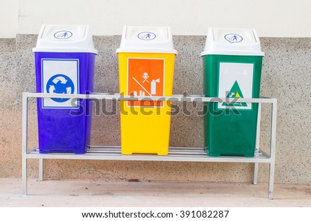 Three bins placed in the trash. The campaign was a waste. - stock photo