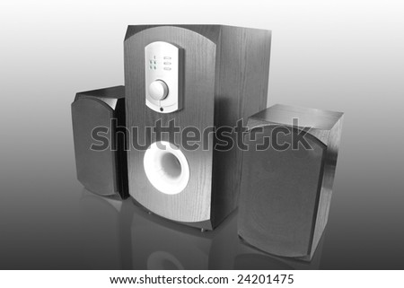 three black computer speakers with built in amplifier isolated on white with reflection - stock photo