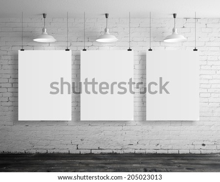 three blank frame in brick loft room - stock photo