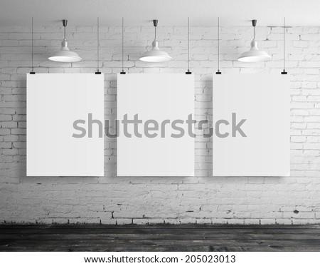 three blank frame in brick loft room - stock photo
