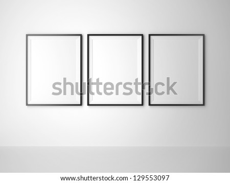 three blank frame on white wall - stock photo