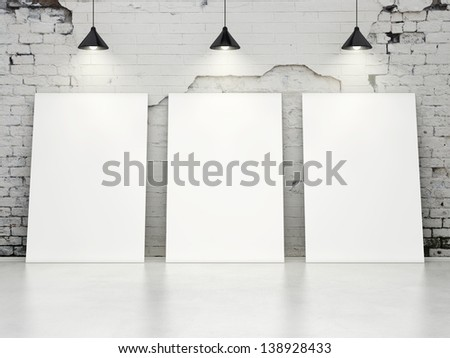 three blank posters on old brick wall - stock photo