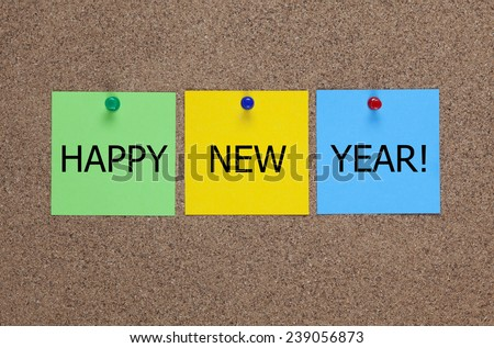 Three blanks post-it notes on cork board (bulletin board) with words Happy New Year!  - stock photo