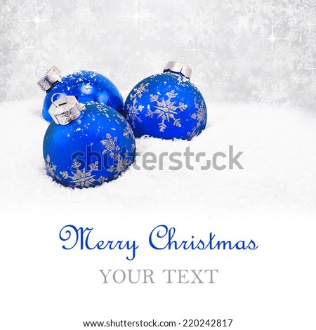 Three blue christmas balls on silver background - stock photo
