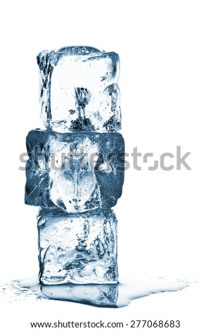 Three blue ice cubes stacked over white background with water - stock photo