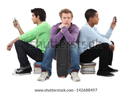 Three bored male students - stock photo