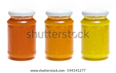 Three bottle of jam on white background - stock photo
