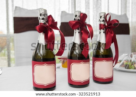 three bottles of champagne with red ribbon - stock photo