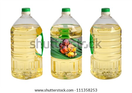 Three bottles of cooking oil isolated on white background. Clipping path included. - stock photo