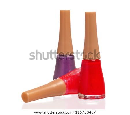 Three bottles of nail polish isolated on white background - stock photo