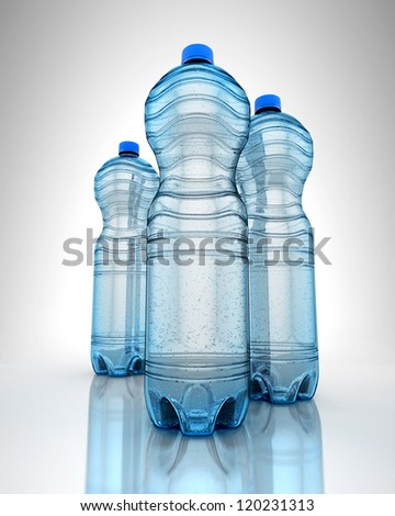 Three bottles of water on reflection surface - stock photo