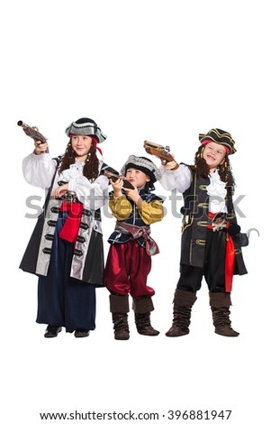 Three boys dressed as pirates posing with guns. Isolated on white - stock photo