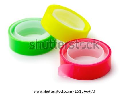 Three bright adhesive tape rolls isolated on white - stock photo