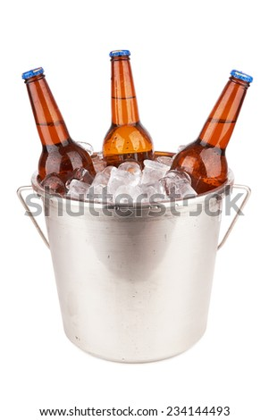 Three brown beer bottles in a bucket of ice isolated on a white background. - stock photo