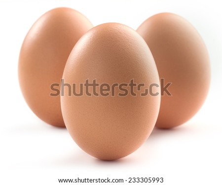 three brown eggs isolated on white background - stock photo