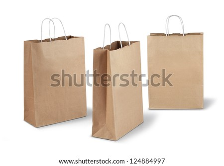 Three brown shopping paper bags isolated on white background - stock photo